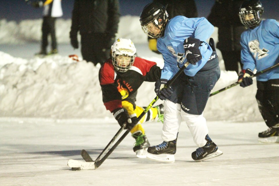 A Canadian tradition was brought back to Chestermere Dec. 27 to 29, 2019, when the second annual Western Canadian Pond Hockey Championship was held on the lake. The tournament featured dozens of teams of all ages. Photo by Scott Strasser/Rocky View Weekly