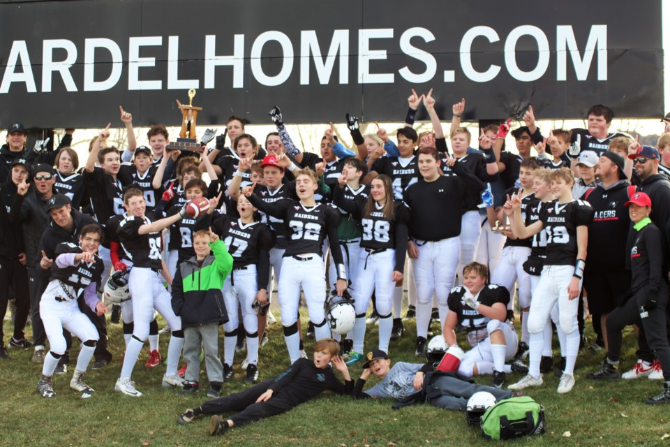 The Airdrie Raiders bantam football team won the CBFA Division 2 championship Nov. 2, downing the Calgary Bulldogs 16-15. Airdrie won the game by tipping the Bulldogs' field goal attempt on the final play. Photo by Charlotte Collington/For Rocky View Publishing