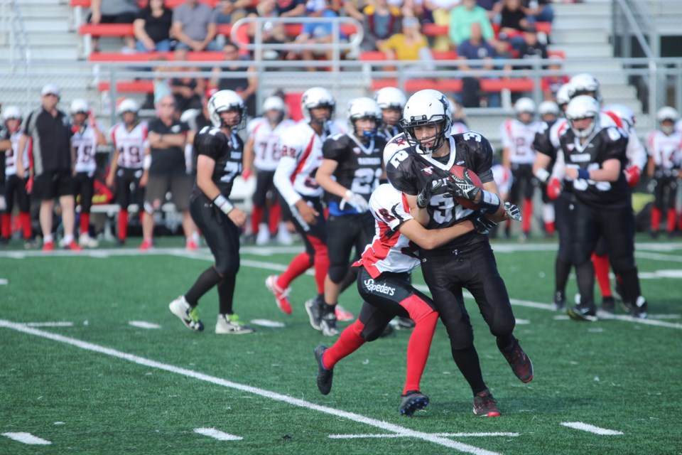 The Airdrie bantam Raiders kicked off the 2019 CBFA season Aug. 24 with a 32-8 loss to the defending provincial champion, the Calgary Stampeders.  Photo by Scott Strasser/Rocky View Publishing