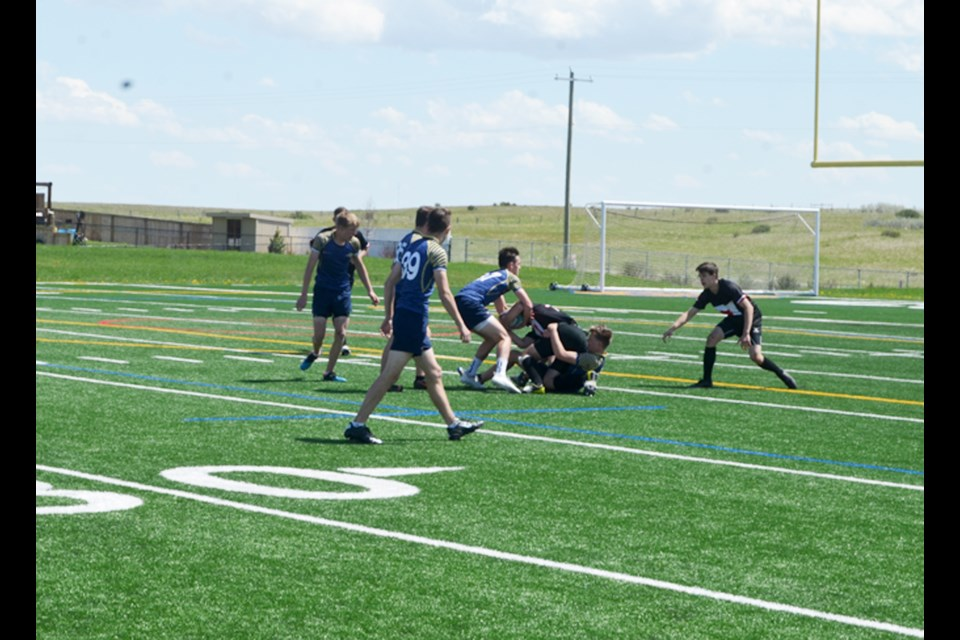 The Chestermere Lakers and the Bow Valley Bobcats square off June 4 at the RVSA rugby 7s divisional championship tournament, in Cochrane.  Photo by Troy Durrell/Great West Newspapers