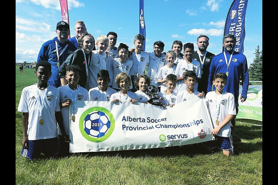 The Springbank Soccer Club's U13 boys' Tier 1 team made history by securing the club's first Tier 1 provincial championship Aug. 25, with a 1-0 win over the St. Albert Impact in the championship final. Photo submitted/For Rocky View Publishing