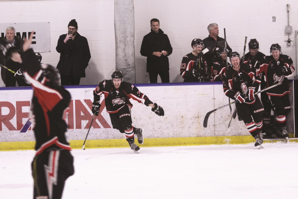 Coach Derek Stamp (back bench, middle) will not continue with the Airdrie Techmation Thunder, after three seasons with the junior B team. Photo by Scott Strasser/Airdrie City View.