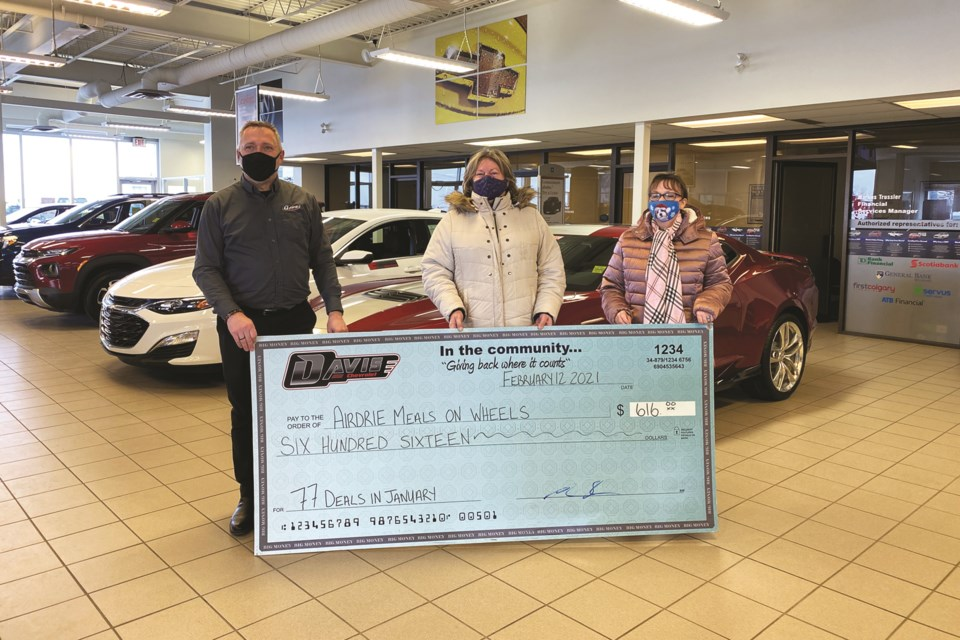 Davis Chevrolet donated $616 to the Airdrie Meals on Wheels Society, as part of the auto dealership's Wheels for Meals campaign. Photo submitted/For Airdrie City View