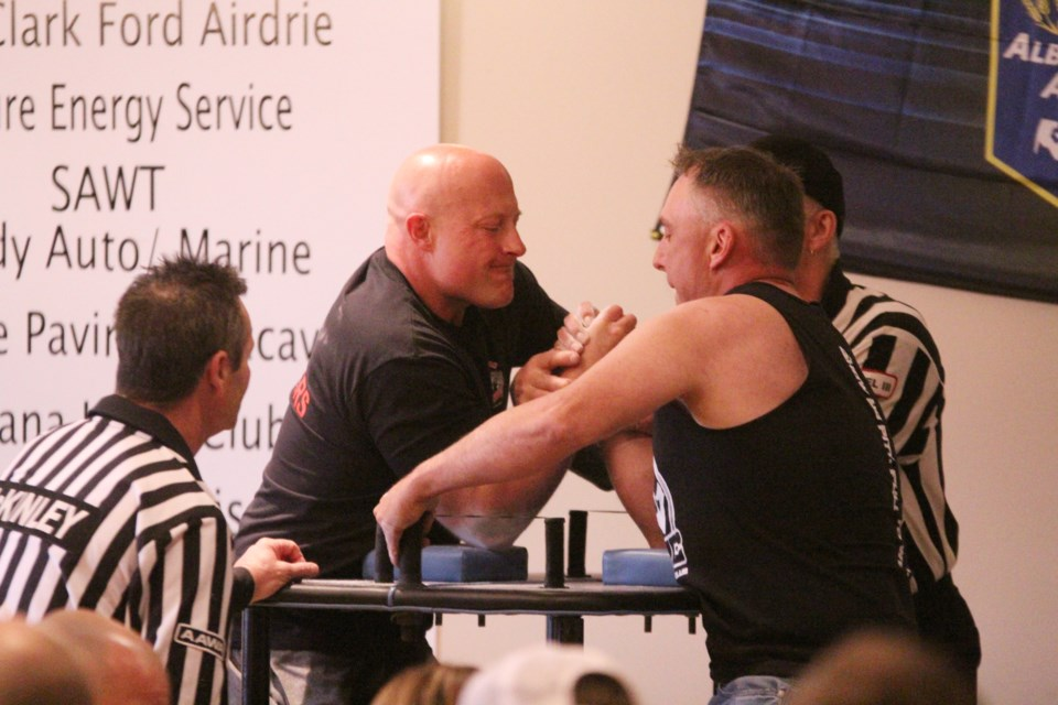 Competitive armwrestlers from across Alberta were in Airdrie May 25 for the 2019 Alberta Arm Wrestling Provincial Championships. Among those representing the Airdrie Arm Wrestling Club was Dale Kotyk (right) who competed to a second-place showing in the men's under-200-punds weight class and a third-place showing in the men's over-200-pounds weight class.  Photo by Scott Strasser/Rocky View Publishing