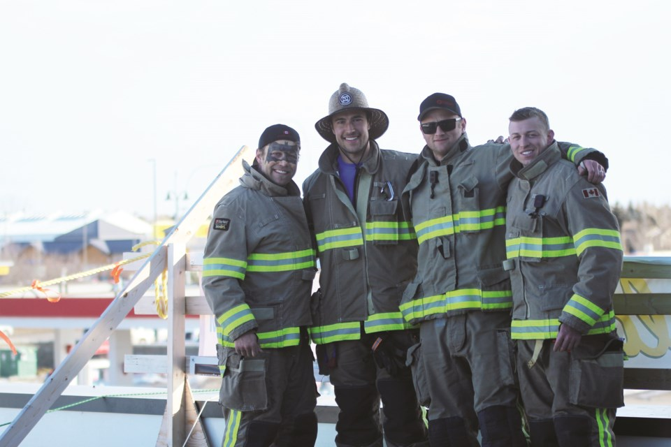 The seventh annual Airdrie Firefighters Rooftop Campout took place Feb. 19 to 22 at the Toad 'n' Turtle Pubhouse & Grill.  (Left to right) Travis Smutt, Isaiah Hoeppner, Justin Furhiman and Billy Dowling were the four Airdrie Fire Department firefighters Four members who camped on the pub's roof for 72 hours to raise money for Muscular Dystrophy Canada. Photo by Scott Strasser/Airdrie City View