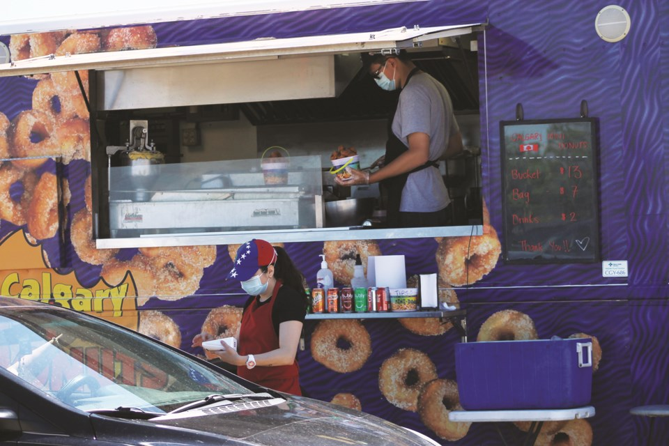 The Airdrie Farmers' Market hosted its second Food Truck Frenz-Thru event July 17 to 19 at the Ron Ebbesen Arena parking lot. Photo by Scott Strasser/Airdrie City View.