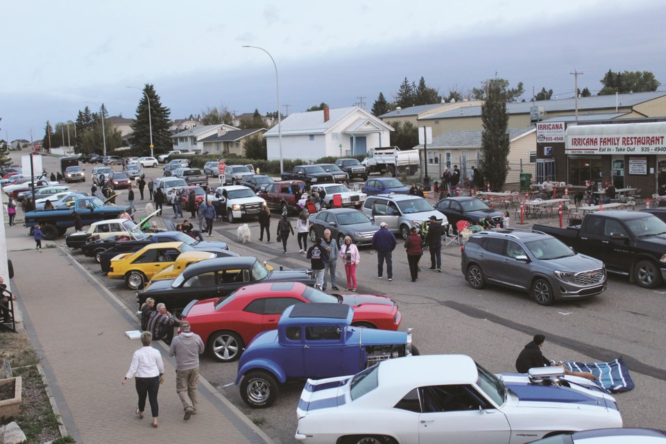 Irricana was abuzz with activity Sept. 12, when the town hosted a classic car parade and drive-in movie screening on Main Street. Photo by Scott Strasser/Rocky View Weekly.