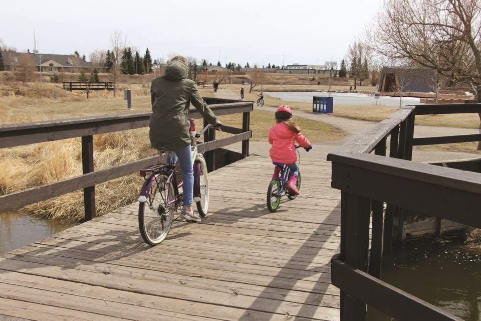 Plenty of cyclists were out cycling in Nose Creek Park on a recent Saturday, taking advantage of the warm weather and dry paths.