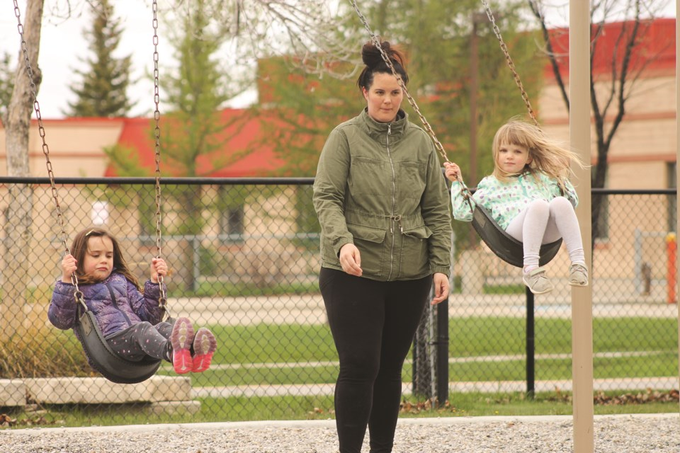 Airdrie families took advantage of re-opened playgrounds May 23, after the City of Airdrie relaxed restrictions on the facilities the night before. Photo by Scott Strasser/Airdrie City View.