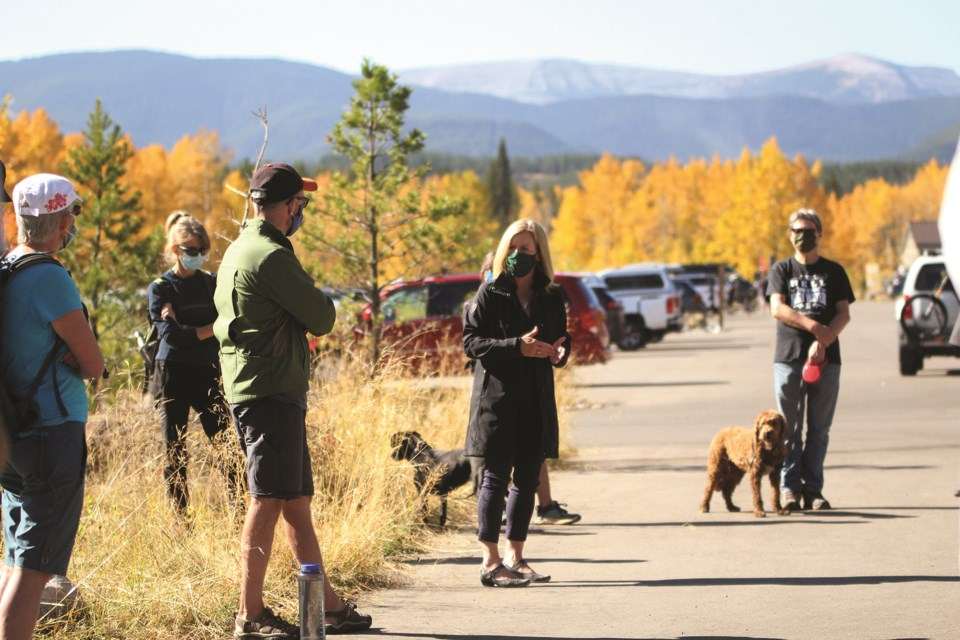 Alberta NDP Leader Rachel Notley (center) was in West Bragg Creek Oct. 2 to meet with members of the Greater Bragg Creek Trail Association for a short hike and discussion about her party's Don't Go Breaking My Parks campaign. Photo by Scott Strasser/Rocky View Weekly.