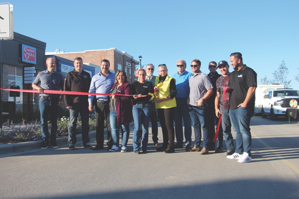 After more than a year of construction, members of Crossfield Town council, Town administration and representatives from Stantec Consulting Ltd. and Professional Excavators and Construction Inc. cut the ribbon to officially open Railway Street on Sept. 13. The ribbon-cutting accompanied the Town's annual community fest, which included food trucks and booths advertising local programs and clubs.