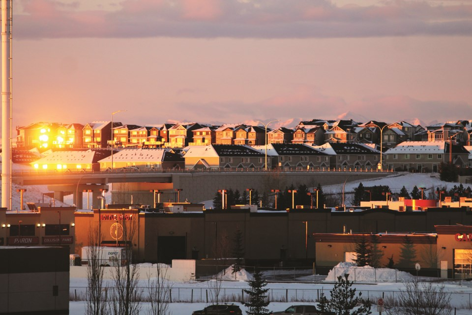 The rising sun shines on a row of Airdrie houses on the west side of Highway 2, Dec. 30.