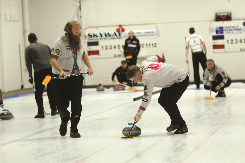 Sixteen men's curling rinks competed at the Airdrie Curling Club's annual McKee Homes Fall Curling Classic Oct. 10 to 12. The annual bonspiel serves as a leg of the World Curling Tour. Photo by Scott Strasser/Airdrie City View