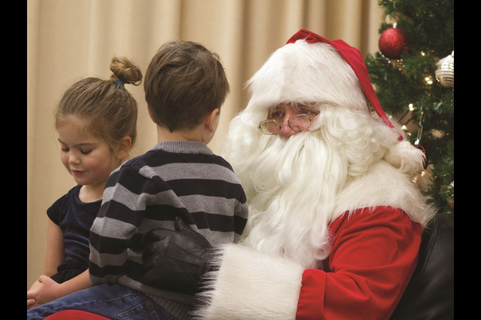 Children had an opportunity to get a photo taken with Santa and tell him their wish lists during Crossfield's Winter Wonderland event Dec. 7. Photo by Ben Sherick/Rocky View Publishing