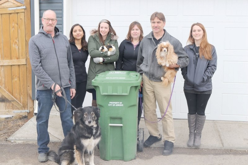 Residents can put pet waste in green organics recyling bins as of April 1. Coun. Ron Chapman with Scooter, Coun. Tina Petrow with guinea pigs Mr. Pip and Dancer and Deputy