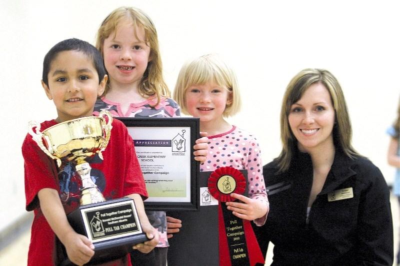 (Left to right) Nose Creek Elementary School students Karman Khehra, Morgan Sorsdahl, Miikka Weigumaap and the Ronald McDonald House's Kristen Staldeker pose for photos