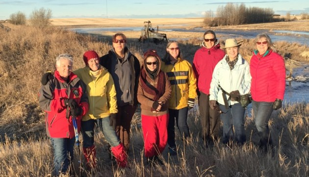 Members of the Meadowlark Society stand along a portion of the future trail connecting Irricana and Beiseker.