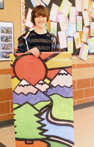 Grade 8 Banded Peak student Nathan Stelfox won a contest to design a new banner for Bragg Creek.