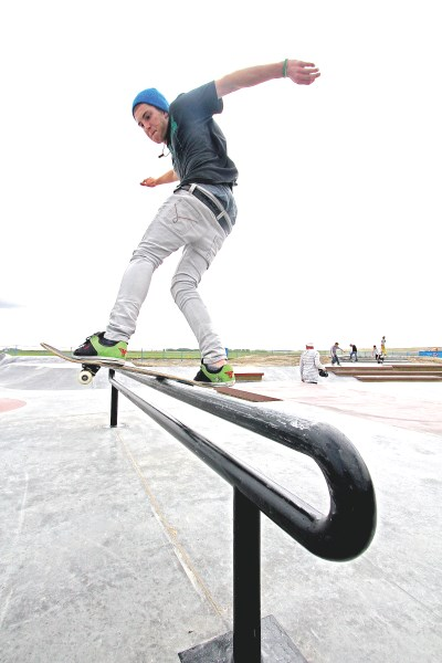 Sixteen-year-old Josh Healey, a team Sully Boardsports skateboarder, rides a rail at the new skatepark in Chinook Winds Park, June 1. The park is finished and open to the