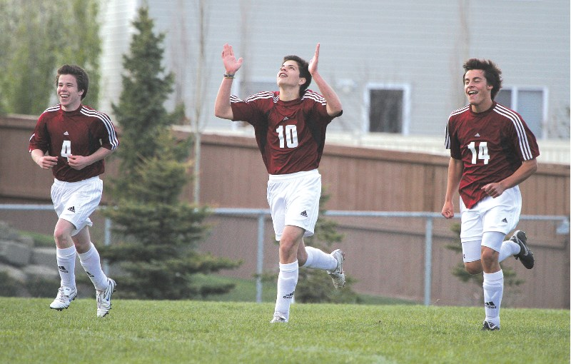 Cochrane Cobras Tomas Assel-Moore, Vini Rescend, and Zach Kerr celebrate a goal late during the Rocky View Sports Association bronze medal match, June 1.