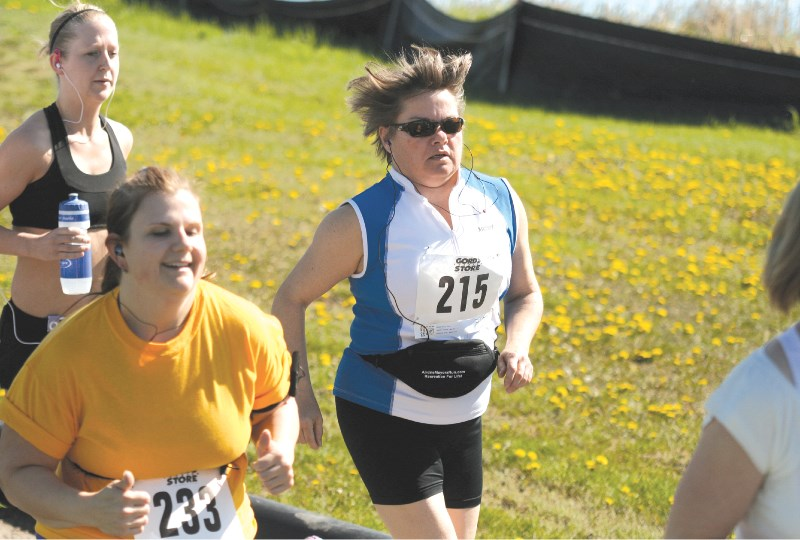 Airdrie Mayor Linda Bruce takes part in the five-kilometre race during the fourth annual Mayor's Recreation For Life Run and Walk at Genesis Place, June 6. Runners