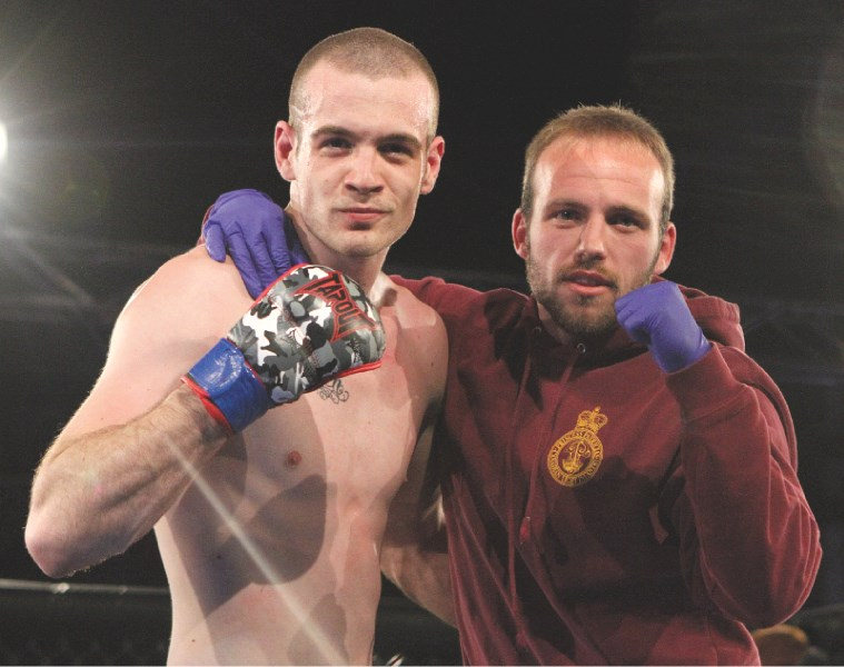Airdrie fighter Adam Lacasse (left) and teammate Gareth Jones pose for a photo after the unanimous judges decision in Lacasse' favour during School of Hard Knocks 7,