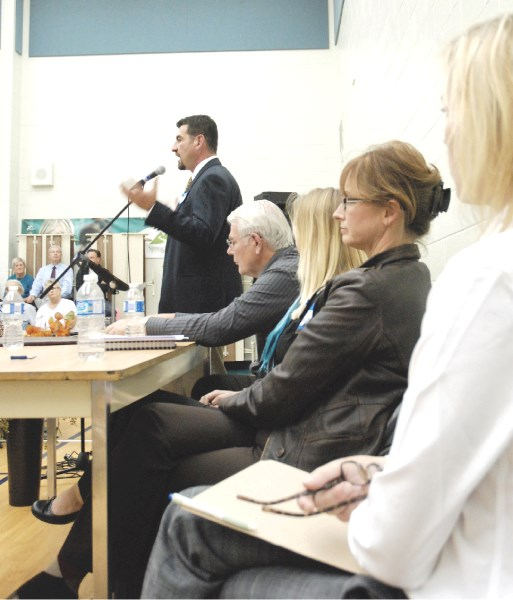 Division 3 candidates Christine Pennell, Margaret Bahcheli and Breanna Sikorski, along with moderator Jim Willson, take in opponent Jay Sarhan's vision of Rocky View at