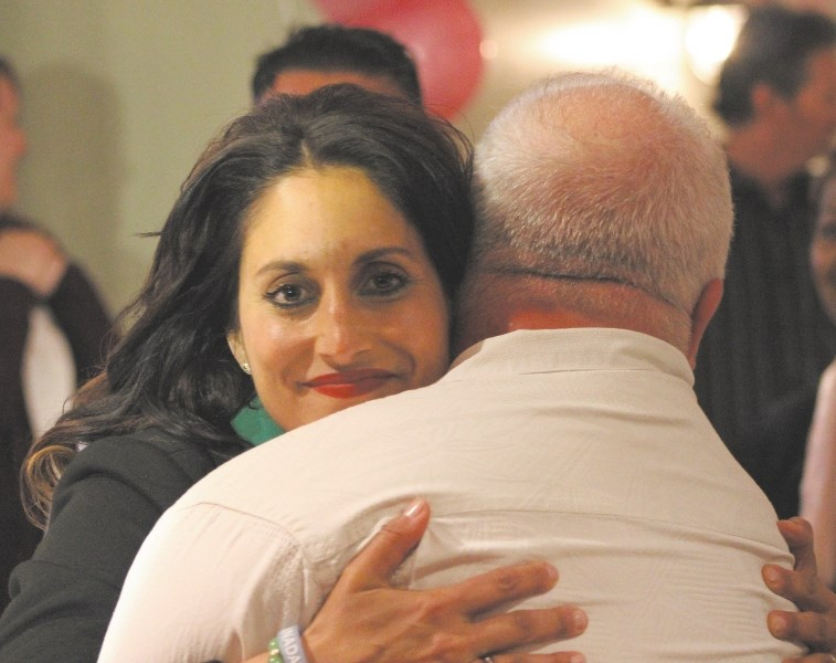 Leela Aheer hugged Campaign Manager Patrick Bergen and thanked supporters while she waited for election results on May 5 at Chestermere Landing. Aheer won the
