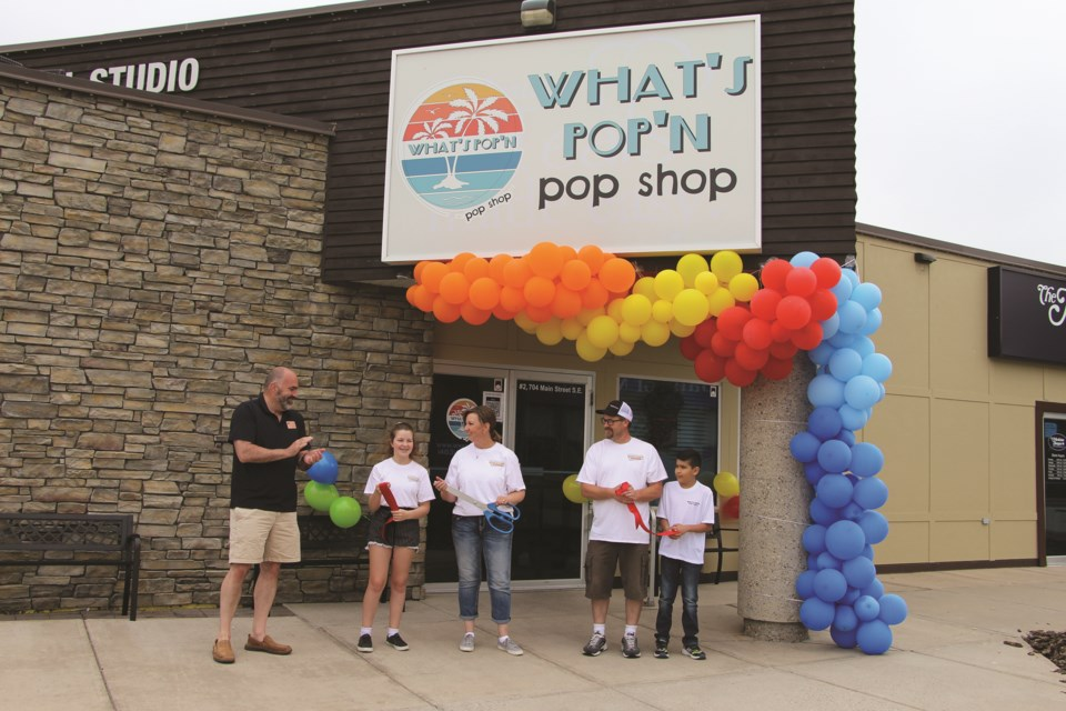 A ribbon-cutting ceremony performed by Airdrie Chamber of Commerce members took place at the grand opening of What's Pop'n Pop Shop on July 17.