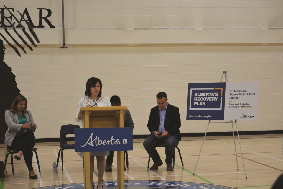 Alberta Minister of Education Adriana LaGrange speaks at St. Martin de Porres High School in Airdrie on Aug. 16. The provincial government has committed $40 million to modernize and create an addition for the school.