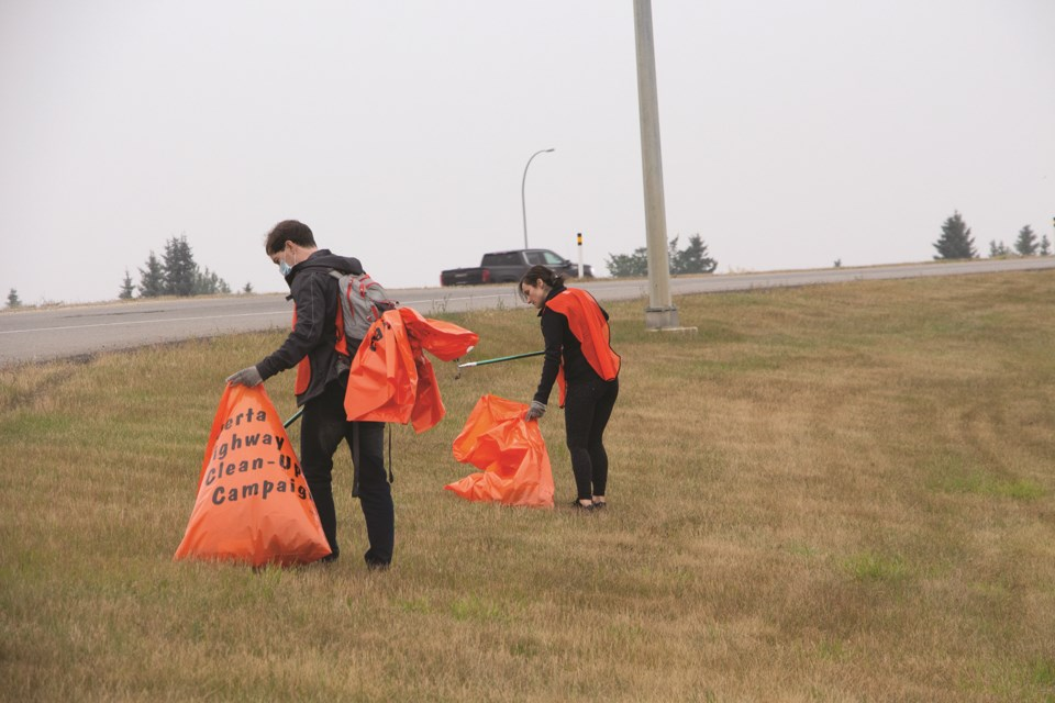 Local volunteers took time on a smoky Saturday to join Volunteer Airdrie in cleaning the Queen Elizabeth II Highway Sept. 19. Photo by Jordan Stricker/Airdrie City View