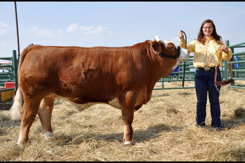 Grace Trask, of the Wonowon 4-H club, with her grand champion steer.
