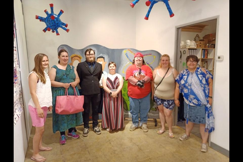 Fort St. John Association for Community Living artists Andrea Conkin, Christine Eicher, Tyler Lillico, Miranda Laboucane, Michael Fraser, Carmela Klassen, and Megan Doerksen.