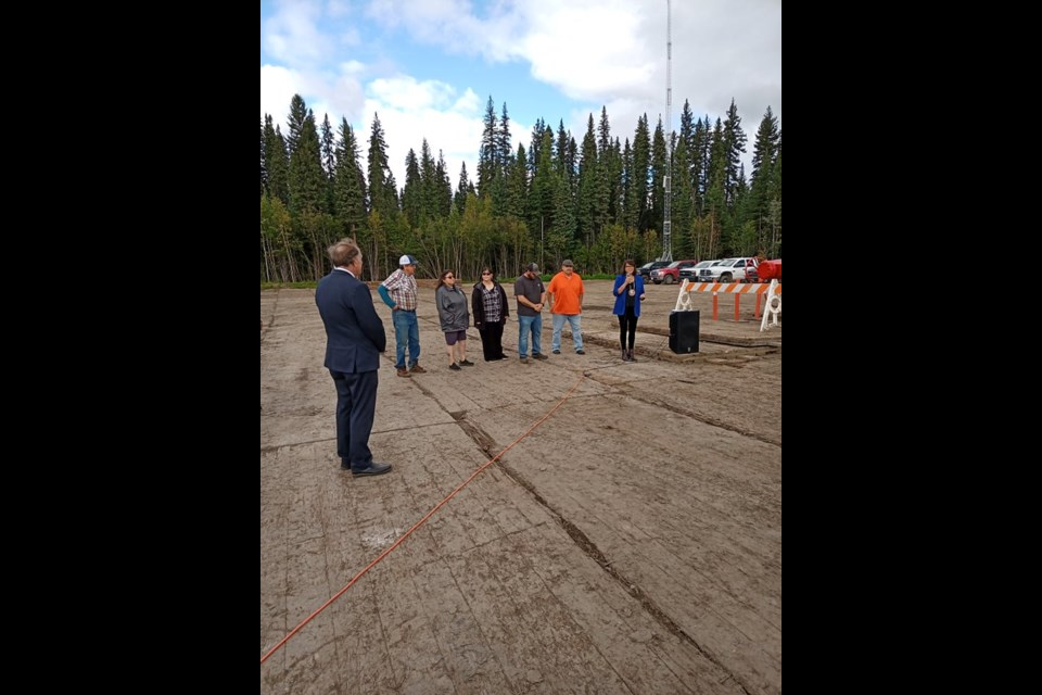 Fort Nelson Chief and Council stand with Northern Rockies Mayor Gary Foster at the injection wells which will power the Tu Deh-Kah Geothermal facility.