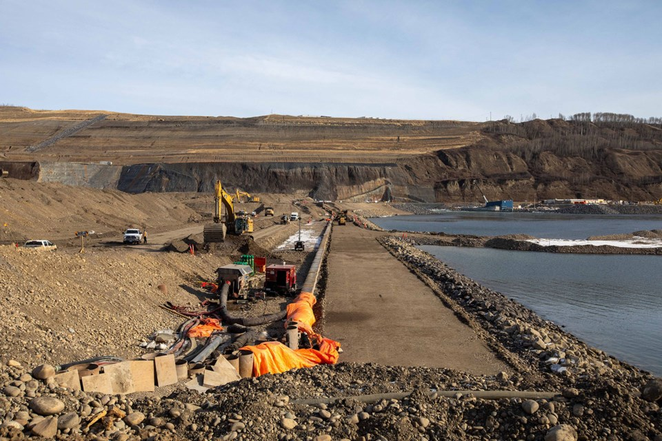 Crews have completed the downstream cofferdam at Site C, March 2021. With both the upstream and downstream cofferdams now complete, crews can begin constructing the earthfill dam.