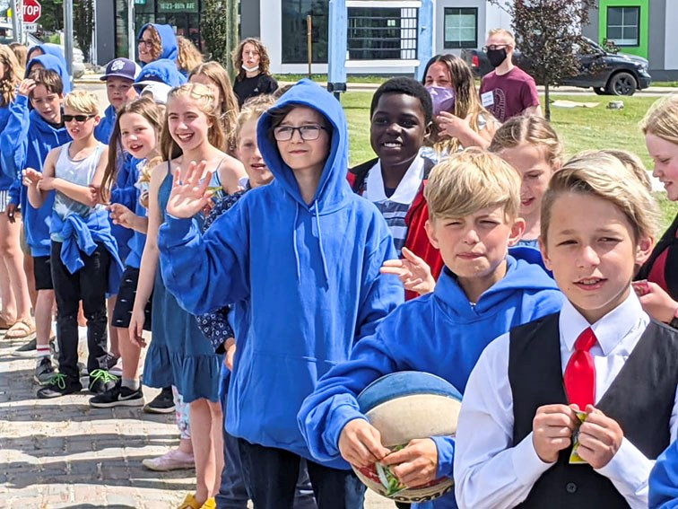 Students await their family and friends during the 2021 Ecole Central Grade 6 grad parade, June 23.