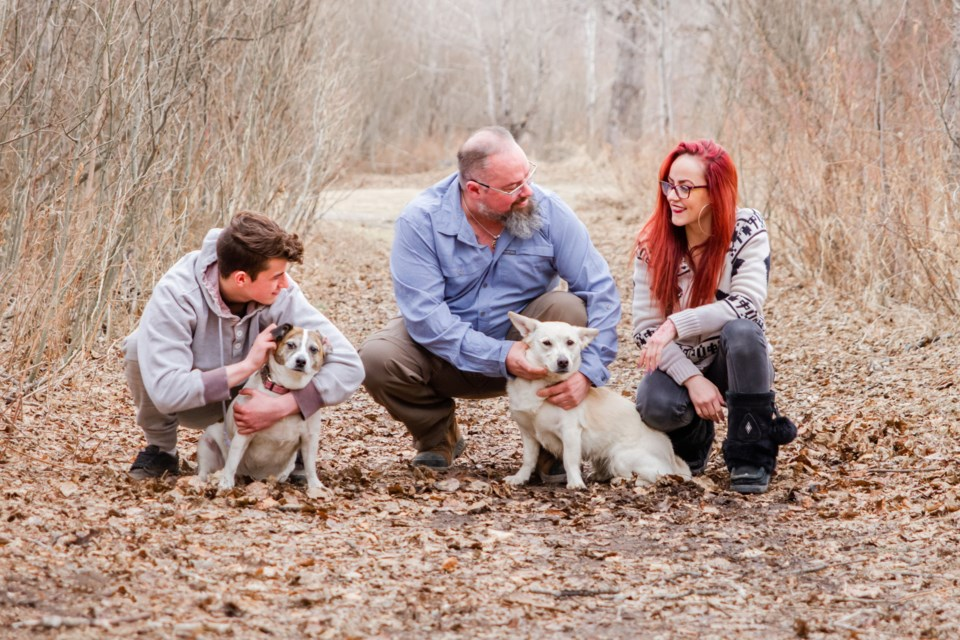 Kaiven Olson, Ryan Olson, and Asia Olson, with dogs Roxy and Lotus, enjoy the early spring weather as a family.