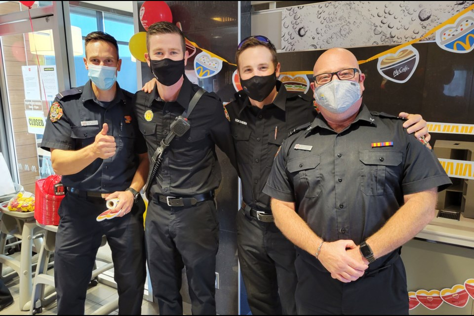 Fort St. John firefighters Alyn Stobbe, Chris St. Cyr, Jayden Ockenden, and Marco D'Agostino handing out stickers and accepting donations at McHappy Day.