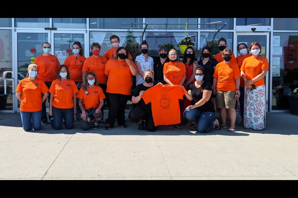 Home Hardware and SJA Promo staff, along with members of the FSJ Friendship Society, gathered today for the launch of their orange shirt fundraiser. All proceeds from shirt sales will go toward the Friendship Society.