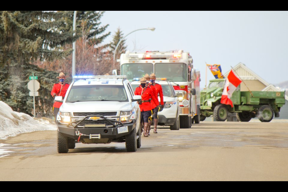Fort St. John Mounties donned their red serge uniforms and led the way during Ingvar Nelson's birthday parade, April 10, 2021.