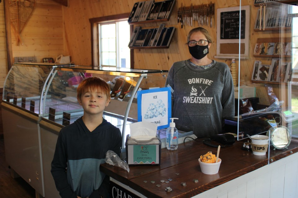 Ryder Nelson drops in to the Taylor Trading Post to enjoy some ice cream, served up by Angie Enns.