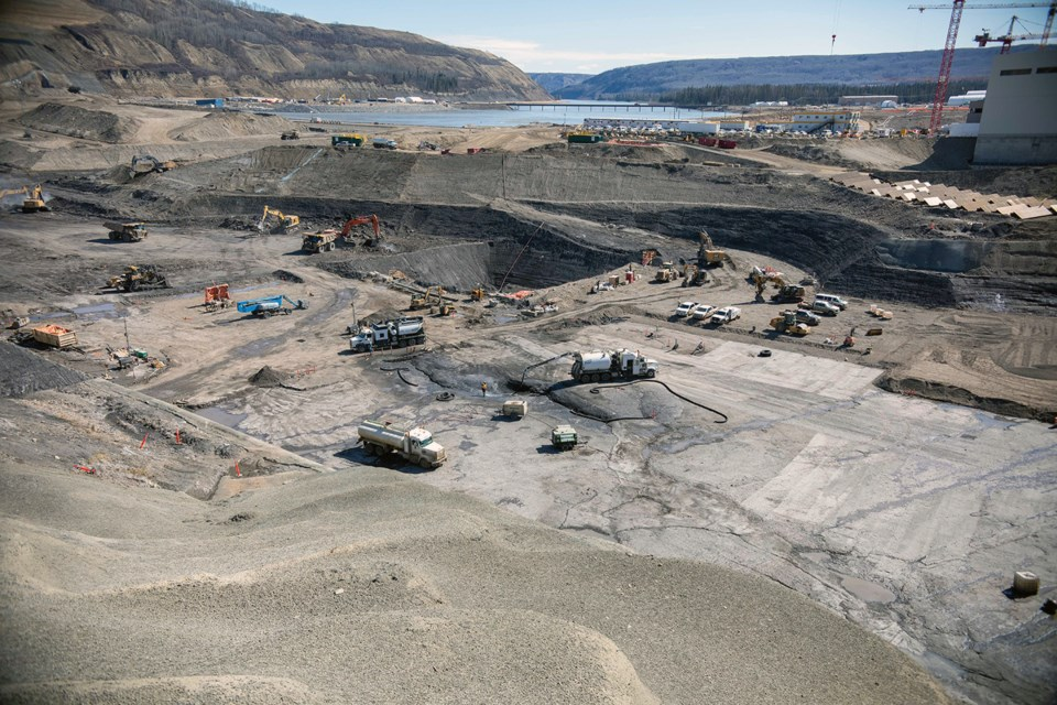 Crews clean the bedrock and excavate the dam core area where the earthfill dam will be constructed, April 2021.