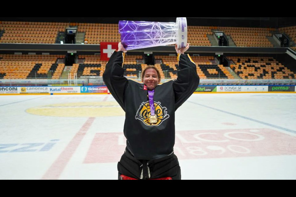 Alexandra Lehmann lifts the SWHL A championship trophy after beating the ZSC Lions 1-0 in Game 4, March 28, 2021.