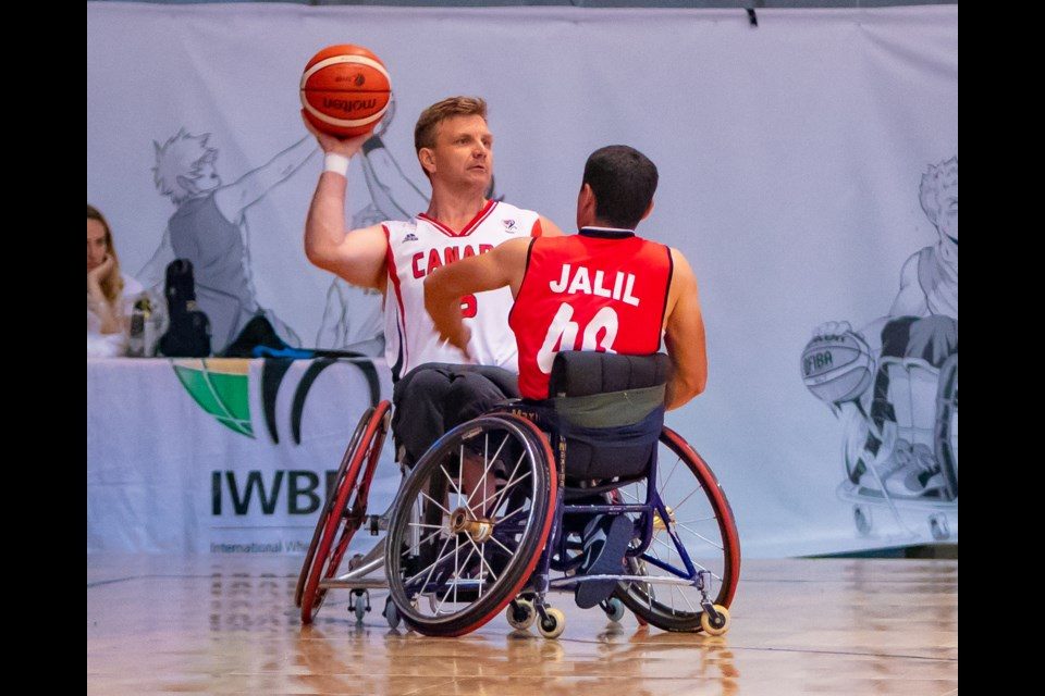 Bo Hedges looks to make a pass while facing Iran in the 2018 World Wheelchair Basketball Championships, will make his fourth Paralympic appearance this August in Tokyo.