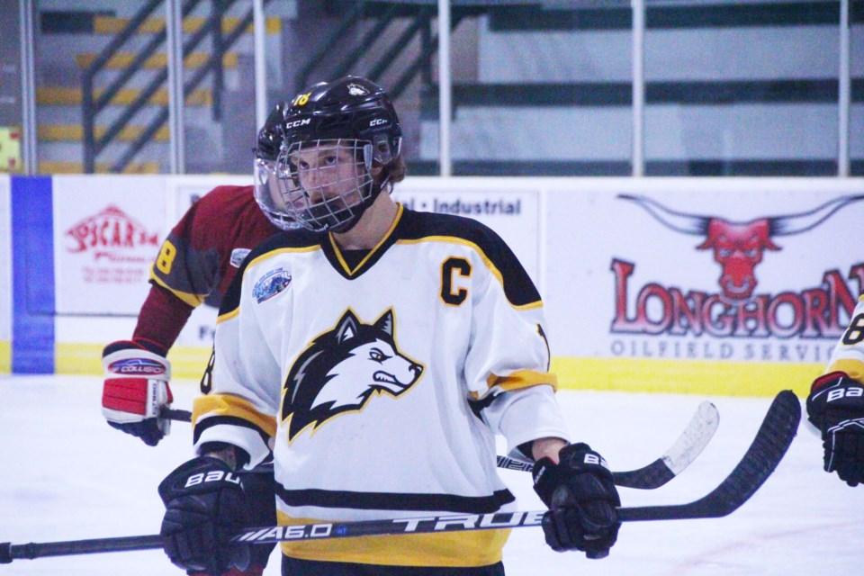 Huskies captain Cayden Frenette prepares to take a draw against the Dawson Creek Kodiaks.
