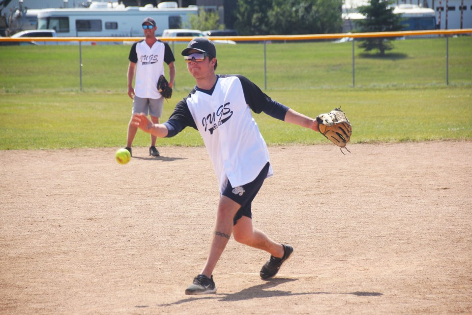 Chase London delivers a pitch for his team against the Brew Jays during the Fort St. John 2-Pitch Poker Tournament on July 25, 2021.