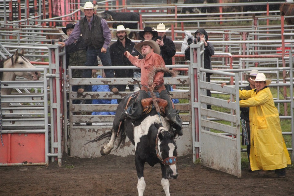 Colton Crook of Fort St. John hangs on to his horse for dear life on Saturday, before winning the saddle bronc event on Sunday at the 2021 Halfway River Rodeo.