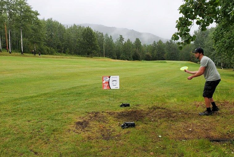 Adam Lionas throws his tee shot on hole 17 at the Moberly Lake Mando, July 18.