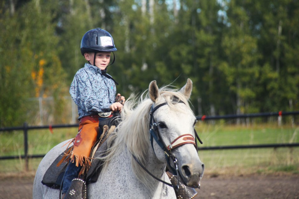 Cutter Giesbrecht rode his horse to the finish line during the poles event, at the Fall Fair Gymkhana events, September 11, 2021.