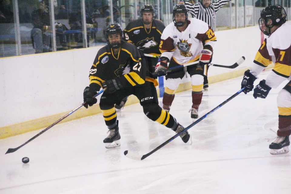 Kurtis Lee brings the puck into the Kodiaks' end during the Huskies 5-0 exhibition win. Lee had an assist in the game.